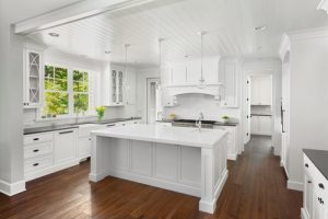 all white large open kitchen