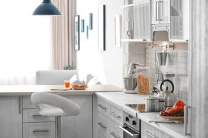modern white kitchen with barstool