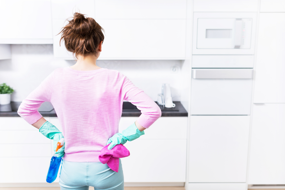 woman cleaning in kitchen