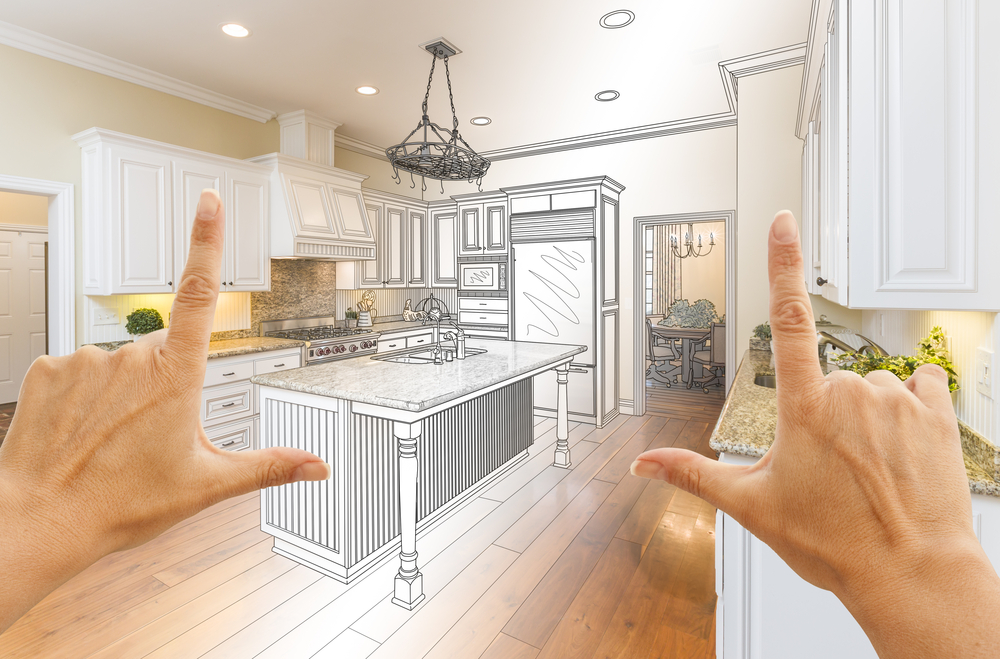Female Hands Framing Gradated Custom Kitchen Design Drawing and Photo Combination