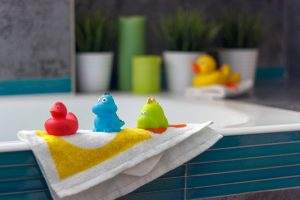 rubber toys in the bathroom, yellow duck and bath decor elements