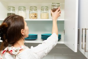 woman organizing kitchen