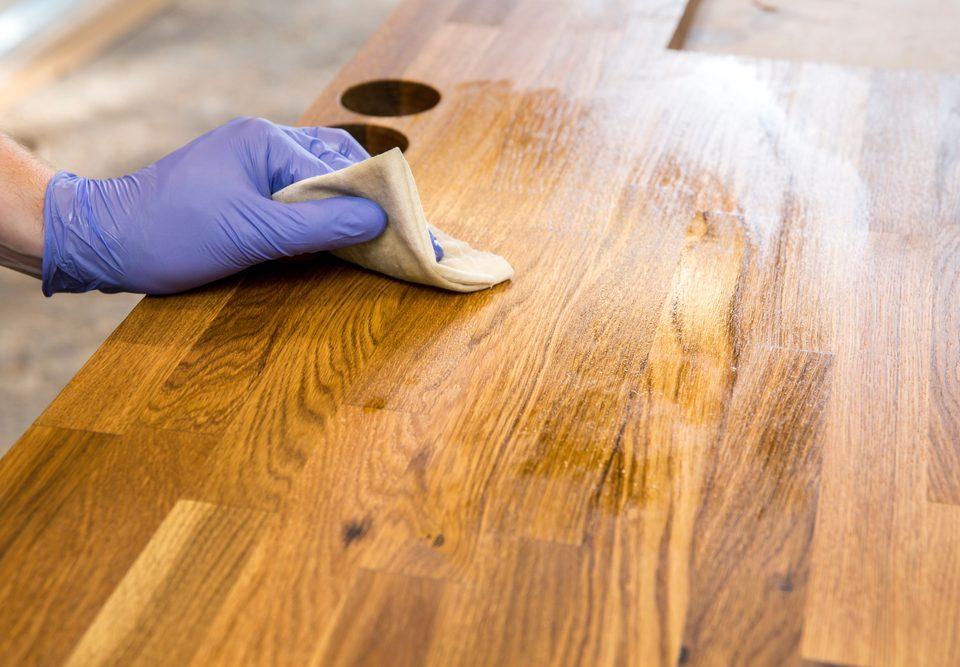 butcher block countertop being cleaned